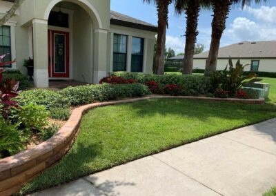 Front of home landscaping with brick retaining wall